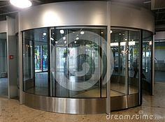 Photo about This is a revolving door in a Swiss Airport and Bus station. Image of revolving, glass, door - 72102642