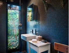 baths-black-tile-walls Marble topped side table for bathroom