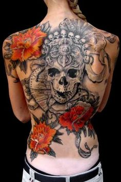 Skull tattoo with flowers, black/grey with minimal color