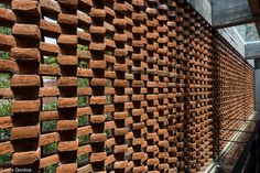 an old home is converted into three modular spaces and a workshop wrapped in large glass doors and brick lattice wall. Brick Architecture, Contemporary Architecture, Architecture Details, Brick Design, Wall Design, Brick Images, Lattice Wall, Wall Exterior, Metal Pergola