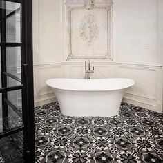 Our Verona freestanding bath got a home in this chic Parisian inspired bathroom