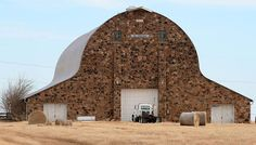Located on Hwy 177 between Ponca City and Stillwater, Oklahoma. The sandstone barn was built in 1941 by the Richard Schultz family prior to World War II (Richard was a banker). It took 4 years to build this barn which is 55 feet tall and is 15,000 square feet. It's capable of holding 60,000 square bales of hay.  It is said that it has pine and hemlock fir trusses and if dismantled the wood could stretch as far as 9 miles long.