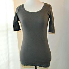 """Mossimo Supply Co. Gray Casual Tee Gray crewneck tee by Mossimo Supply Co. Has elbow length sleeves and a fitted silhouette. Great casual basic for fall! Minor flaw in the stitching on the front at the hem, but in otherwise excellent condition!  Trending: Gray    Measurements   Size: X Small Length: 24"""" Bust: 29"""" Sleeve Length: 10.5""""    Materials   100% cotton. Mossimo Supply Co. Tops Tees - Short Sleeve"""
