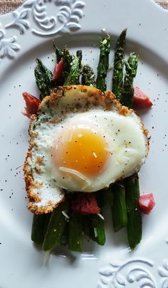 There are a few things I found out this morning.   1. You can turn asparagus into breakfast.  2. You can fry an egg in breadcrumbs.    If you need a little motivation to get out of that cozy bed this.is.it. Crispy roasted asparagus topped with some bacon (or ham), breadcrumb fried egg, and Parmesan...