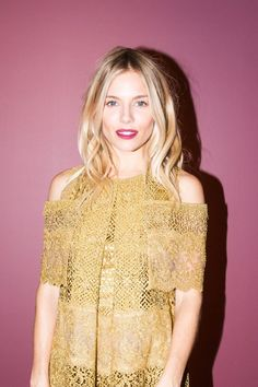 Sienna Miller On Her Style, Beauty Routine, and More: We got the chance to sit down with her to talk about her role in Burberry's take on a Christmas film, The Life of Thomas Burberry. -- Yellow lace open shoulder dress. | Coveteur.com