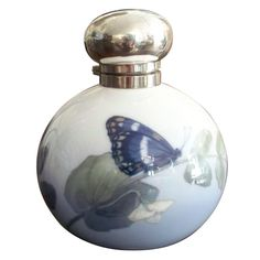 Art Nouveau Period Porcelain & Sterling Perfume Bottle, 1913. ROYAL COPENHAGEN porcelain bottle handpainted by painter #70 with sweet pea flower and landed butterfly. The neck and hinged lid are George BETJEMANN & Sons, English sterling silver. (hva)