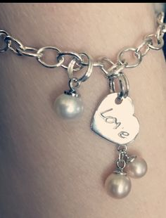 My pearl wrist charm bracelet and love me two times charm. My sweety loves me.