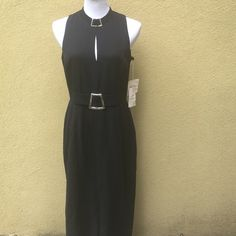 Black dress. Care: dry clean only. Size 12 Black dress. New. Deep slit to front and back of dress.  3rd pic shows you what it looks like. Lining under one of the armpit has small discoloration. Datiani Dresses Maxi