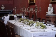 long table decorated with candelabras and mound of spring flowers