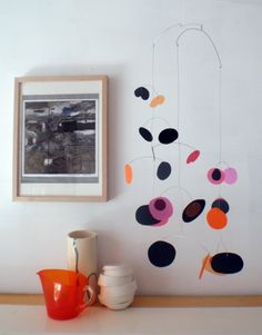 Sprout modern kinetic mobile - Autumn colours - orange pink black ( by Pukapuka)