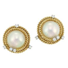 Pair of Gold, Platinum, Mabe Pearl and Diamond Earclips, Tiffany & Co., Schlumberger   18 kt., centering 2 mabe pearls approximately 14.2 mm., encircled by spirals of rope-twist gold, accented by 10 round diamonds approximately .60 ct., signed Tiffany & Co., Schlumberger Studios. With signed box.