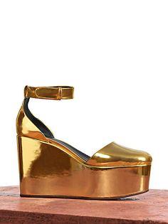 Gold metallic leather flatform clogs, don't hate.  CÉLINE