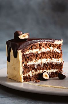 Frangelico-spiked dark chocolate crowns this hazelnut cake layered with Nutella and peanut butter frosting. Nutella Recipes, Chocolate Recipes, Chocolate Cakes, Just Desserts, Delicious Desserts, Yummy Food, Baking Recipes, Cake Recipes, Dessert Recipes