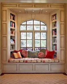 Window seat, we have window seats in every room except the Kitchen i think i want to build the book case areound a few of them!