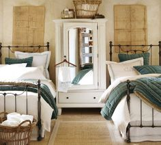 Shared room with two beds. love the metal headboard and footboard with the baskets at the end of the bed.
