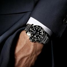 The classic Rolex Submariner in timeless black.