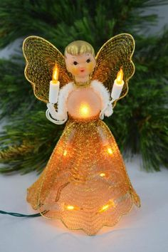 This offering is for a vintage lighted angel tree topper. This pretty little thing has find gold mesh and gold lights. She is in great vintage condition for her age. She works and the mesh is in decent shape.  She measures 6.5 inches tall and is about 4 inches in diameter across the bottom.  I am happy to combine ship and refund shipping overages of $1.00 or more.  Thank you for looking! To return to my shop, please click below: www.etsy.com/shop/MichelleGrant920  A115