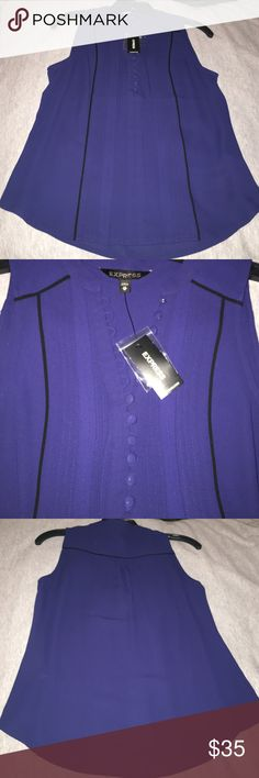 👚Dark Blue Express Shirt👚 👚Selling a Dark Blue Express shirt. NWT, never worn, it just doesn't fit me right it's a little too big on me. Size is XS. Great blouse for dressing up and going to work.👚 Express Tops Blouses