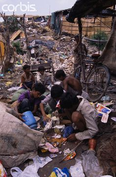 Scavenging in Delhi Slum I WAS NOT BORN IN DELHI, I WAS BORN IN MATURIN VENEZUELA, AND I CAN COFESS TO ALL OF YOU , I KNOW ,VERY WELL THAT WAY OF LIFE...BECAUSE I GREW UP LIKE THAT ,UNTIL MY FATHER CAME BACK HOME...WE DID NOT KNOW BETTER BUT WE WERE HAPPY WHEN WE FOUND SOMETHING WE NEEDED AND COULD USE...I REMEMBER FEELING UP IN THE TOP OF THE WORLD...GOD IS GOOD...