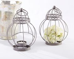 The soft flame of a tealight dances like a bird's wings when nestled inside this beautiful Vintage Bird Cage Lantern! An excellent piece to incorporate into your table settings as you set the mood for