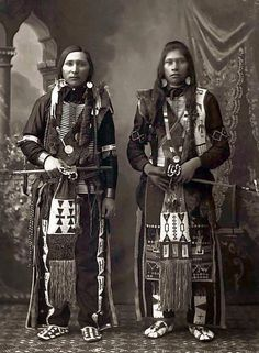 Two Shoshone Indian males showing beaded moccasins with beautiful beadwork. 1897