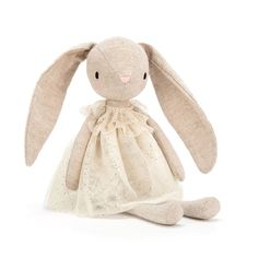 The Jolie Bunny Plush Toy by Jellycat is bouncing with sparkles in a glittering buttercream dress! Flopsy-eared and nuzzly-neutral Bunny Plush, Bunny Toys, Bunnies, Handmade Stuffed Animals, Baby Stuffed Animals, Baby Accessoires, Jellycat, Fabric Toys, Plush Animals