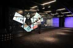 Executive brand suite by Engage Production office design. At 9.9m x 2.1m, this huge installation plays a central role in the delivery of the client's services, and is currently the world's biggest interactive multitouch wall. The wall comprises 24 x 55inch MultiTaction LCD cell displays from MultiTouch Ltd