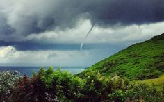 Nicola Symberlist took this photo of a waterspout spinning off the coast near Rhossili in South Wales
