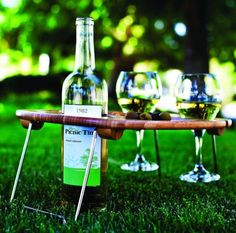 Fancy - Picnic Time Mesavino Portable Wine and Snack Table.  I am struggling to understand why I don't already own this.