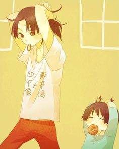 Hetalia: Japan and China. Japan is so freaking cute trying to copy China putting his hair up!!!