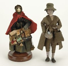 """early to mid 19th century, includes a carved and painted figure of a gentleman in original wooden clothes, also includes a fine quality wooden peddler doll with an array of wares on original base, 6.5"""" t."""