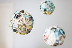Origami balls made by an 11yo out of antique maps