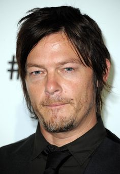Biting his own lip, because WHY WOULDN'T HE. | 36 Photos Of Norman Reedus That Will Give You A Zombie Boner