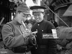 An occupying Japanese soldier communicating with a Chinese policeman by writing…