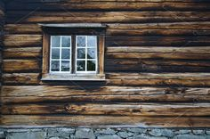 Dark timbered wooden wall with window. Abstract Photos
