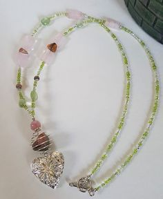 Self acceptance and Heartbreak: Rhodochrosite, Prehenite and Rose Quartz (aromatherapy jewelry)  https://www.etsy.com/listing/270251442/love-yourself-aromatherapy-diffuser