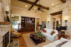 Stone and wood details can enhance any #livingroom, making it your space!