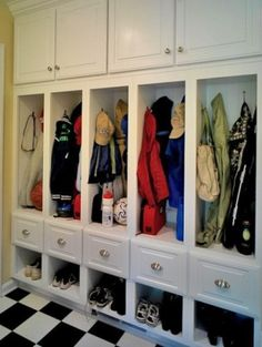 Great cubbies for everything in an entry way or mudroom + the floor is a bonus. By Case Design/Remodeling