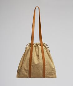 Drawstring Tote in Khaki Crinkle: A drawstring tote bag Soft Leather Handbags, Leather Purses, Pink Duffle Bag, Duffle Bags, Pink Laptop, Black Leather Backpack, Leather Briefcase, Tan Shoulder Bag, Nylon Tote Bags
