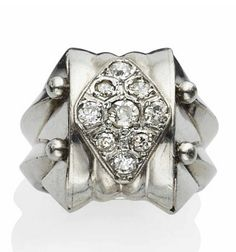 AN ART DECO DIAMOND AND PLATINUM RING, BY RENE BOIVIN