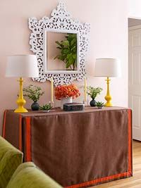 skirted table pulls double duty as a buffet with hidden office storage for filing cabinets underneath