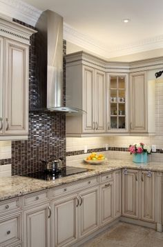 Design Idea- I wouldn't use dark brown kitchen tiles, but it is still an interesting backsplash idea Handmade tiles can be colour coordinated and customized re. shape, texture, pattern, etc. by ceramic design studios Diy Kitchen Remodel, Kitchen Redo, Kitchen Colors, Kitchen Backsplash, New Kitchen, Kitchen Dining, Kitchen Cabinets, Backsplash Ideas, Dining Area