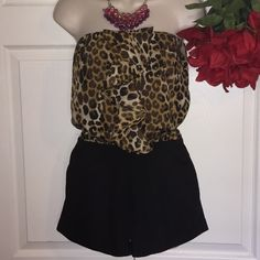 """Express Leopard & Black Romper Leonard print romper with Ruffles in front, elastic waist, 22"""" lenght from armpit to bottom, 25"""" waist with matching sash black belt. shell 100% polyester lining, 95 polyester 5% spandex. ( Please ask questions before buying sale is FINAL / NO RETURN) Express Pants Jumpsuits & Rompers"""