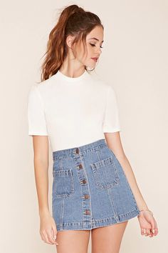 A mini denim skirt featuring a button-down front and two patch pockets.