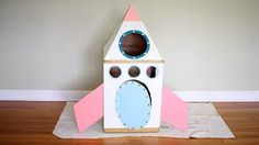 How To Make A Cardboard Rocket Ship For Your Cat Using Old Boxes | Cuteness Cardboard Box Castle, Cardboard Playhouse, Cardboard Toys, Cardboard Furniture, Cardboard Crafts Kids, Cardboard Rocket, Crafts For Kids, Buzz Lightyear Wings, Cat Castle