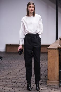 Understated and elegant at Christophe Lemaire—a high black trouser and blousy top in soft white cotton