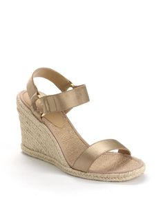 """An elastic strap at the ankle helps give these sandals a snug and comfortable fit. Slip-on style. Open toe. Goldtone ring accents. Jute wrapped heel. Heel height: 3 3/4"""". Jute covered footbed. Synthet"""