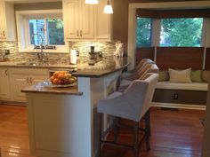 Kitchen curved breakfast bar with super cute stools.