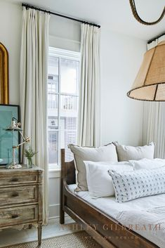 ASHLEY GILBREATH INTERIOR DESIGN: An antique daybed is perfect for this cozy guest bedroom. Neutral tones and drapery mounted at ceiling height help make this smaller space feel bigger. Beautiful Beach Houses, Beautiful Homes, Ashley Gilbreath, Rosemary Beach, Bunk Rooms, Full Bed, Small Dining, Maine House, Contemporary Interior