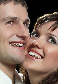 Just DO NOT pose for a wedding photo like this. I thought they were missing teeth. -- Awkward Wedding Photos: The Cringe-Worthiest Stock Wedding Pics (PHOTOS)